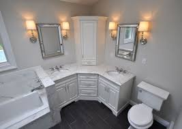 bathroom corner furniture. custom master bathroom with double corner vanity tower cabinet wall sconces toilet and built in tub area bathrooms pinterest furniture