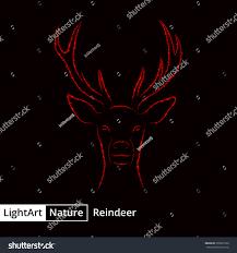 Reindeer Silhouette Lights Reindeer Silhouette Red Lights On Black Royalty Free Stock