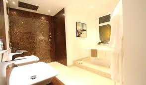 bath tile showroom a luxury bathroom and with rust coloured mosaic and contrasting large porcelain floor bath tile
