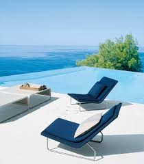 swimming pool lounge chair. Slim Floating Chair With Navy Blue Tone Beside Infinity Pool Of Luxurious Big House Swimming Lounge O