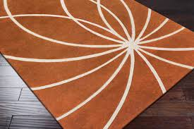 whire and orange area rug