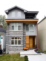 exterior brick colors. trendy three-story exterior home photo in toronto brick colors e