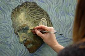 a painter recreates a vincent van gogh self portrait at a studio in the northern polish city of gdansk on december 5 2016 afp