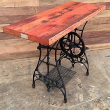 Beautiful antique sewing machine table with a wood top