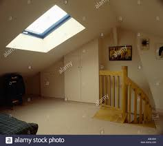 Small Loft Bedroom Cream Carpet In Sparsely Furnished Loft Conversion Bedroom With