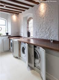 cupboard doors hiding washing machine and tumble dryer fall door blue kitchen cabinet panels sage green