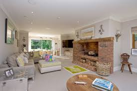 brick fireplace living room traditional with gray carpet large fireplace