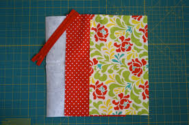 start by applying your interfacing to the back of your outside fabric then using the same technique from my cosmetic bag tutorial