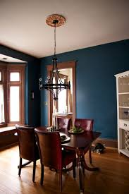 color Dining room- Bringing modern to our old house with a peacock blue  paint job with gold and white accents