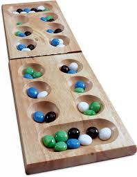 Game With Rocks And Wooden Board