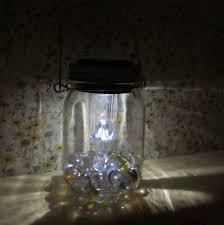 mason jar lantern made with dollar tree supplies fun diy craft idea for the garden