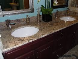cool granite vanity top with bullnose edge and undermount sinks also kitchen faucets
