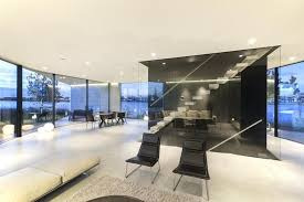 view in gallery diamond shaped house with curving glass windows 10