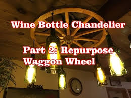 wine bottle chandelier part 2 repurposed wagon wheel
