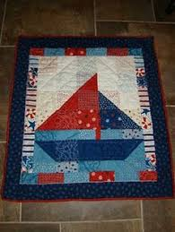 I made about 3 baby quilts so far using this pattern . Always ... & cute sailboat baby quilt Adamdwight.com