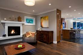 framing mirrors with crown molding living room contemporary with open floor plan fireplace mantel open floor