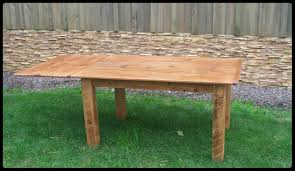 5 ft thin top reclaimed pine table with square company board legs and company board