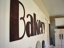Hand painted in  Bakery letters for kitchen. Font: Broadway. Stained by  customer.