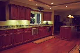 best kitchen under cabinet lighting. strip best led under cabinet lighting white colored light brown wooden material floor marble glossy lit kitchen
