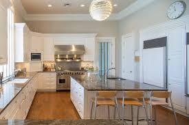 white cabinet kitchen with modern chandelier over island