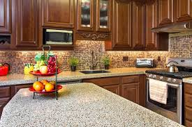 stunning kitchen cabinet and mosaic tile backsplash with recycled glass countertops beautiful for eco friendly countertop