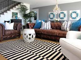 black and white striped rug for formal nautical living room plan with elegant brown sofa