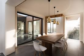 dining table patio doors gold pendant lights modern home in hampshire england
