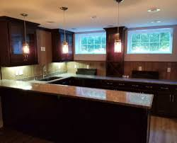 dark color granite countertops kitchen with sink cutout and bartop with dark cabinets