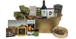 gourmet gift basket with lots of sweet and salty treats and a bottle of wine