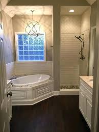 my master bath shower door not yet installed tub surround and floor with ceramic tile bathtub