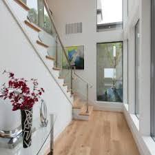 contemporary hallway lighting. Modern Hallway With Light Hardwood Flooring Contemporary Lighting