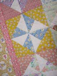 Pinwheel Quilt {Sewing} - Wendys Hat & And the colors of these prints are so cheerful! What baby wouldn't be happy  under a quilt like this? Adamdwight.com