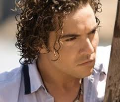 a picture of a curly hair man with his curls styled with a hairstyling cream
