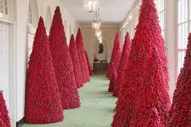 Red Christmas trees along the East Colonnade of White House in Washington. The theme Melania Trump\u0027s \u0027fantastic\u0027 blood-red too