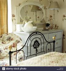 Ornate Bedroom Chairs Ornate Black Wrought Iron Bed In Cottage Bedroom With Tulip