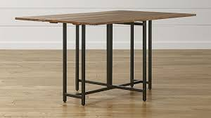 the crate and barrel origami rectangular table on a wooden floor