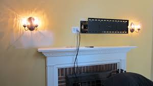 electric fireplace with tv mounted above fireplace mounted tv hide wires