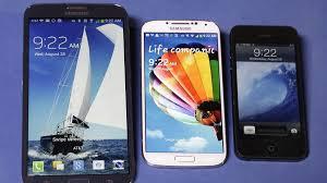 samsung smartphones 2014. the samsung galaxy mega, left, s4, center, and apple iphone smartphones 2014 p