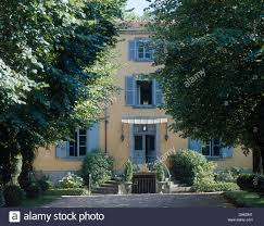 french country front doorBlue shutters on door and windows in large French country house