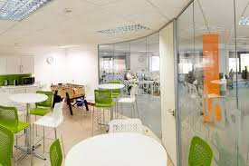 office canteen. Sidetrade Curved Glazed Partition - View From Inside Of The Canteen Office