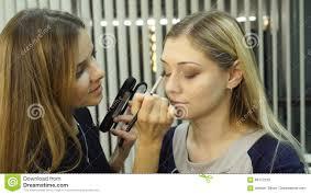 eye makeup woman applying eyeshadow powder beautiful woman face stock fooe video of brush lashes 88172230
