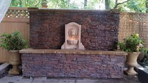 Backyard Water Wall Covered In Regency Stacked Stone Panels