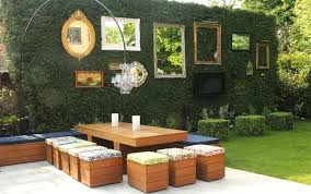 outdoor house decor green wall decorated with mirrors and empty frames gingerbread decorating ideas