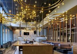 restaurant lighting ideas. Yellow Shade Tiny Pendant Lamp In Bar Restaurant Lighting Design Above Wooden Dining Tables And Light Gray Fabric Sofa Modern Interior Ideas N