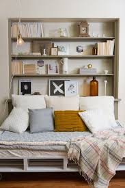 view in gallery bookshelf with bed positioned up against it from one side