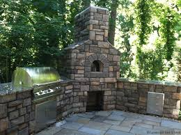 the benefits of an outdoor fireplace or fire pit in landscaping designs