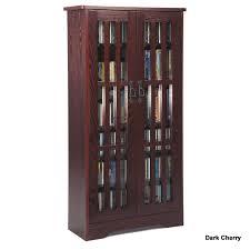 leslie dame cd storage cabinet with glass doors oak walnut or dark cherry m 371