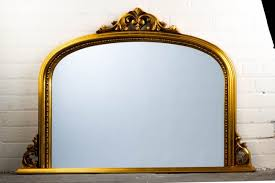 gold ornate over mantle mirror