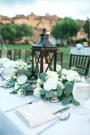 round table centerpieces lantern and greenery centerpiece with flowers only bridal table centerpieces flowers