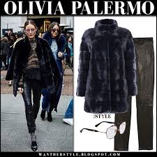olivia palermo in black fur coat cara mila and black leather pants j brand fashion week
